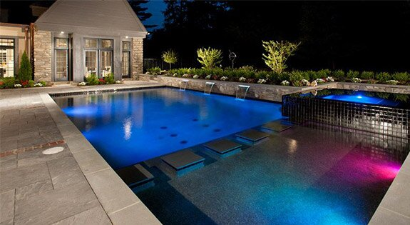 A beautiful pool at night in the winter.